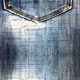 Old jeans background with hole Royalty Free Stock Images