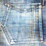 Old jeans background with hole Stock Photo