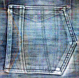 Old jeans background with hole Royalty Free Stock Image