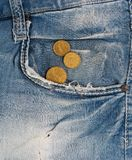 Old jeans with coins in pocket Stock Image