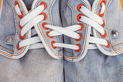 Old jeans sports shoes Royalty Free Stock Images
