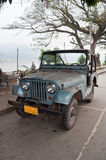 Old Jeep. An old jeep standing on the road of Luang Prabang city, Lao People's Democratic Republic Stock Image