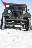 Old jeep on snow Royalty Free Stock Images