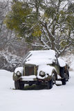 Old jeep in the snowfall Stock Images