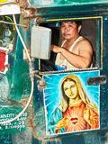 Old Jeepney decorated with a painting of Mother Mary