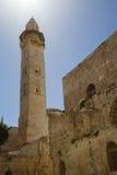 Old Jerusalem. Israel, Old Jerusalem. A fortification and a minaret Stock Photos