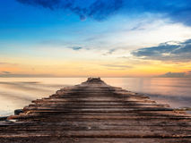 Old jetty at beach Stock Photo