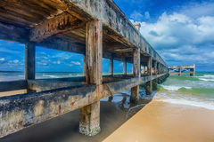 Old jetty at clean beach Royalty Free Stock Photo