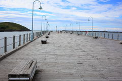 Old jetty of Coffs Harbour. The old timber jetty in Coffs Harbour, NSW, Australia (a popular place to promenade, sit, fish and watch) - with Muttonbird Royalty Free Stock Images