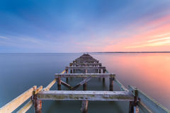 Old jetty at dusk royalty free stock image