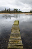 Old jetty at ice break-up Royalty Free Stock Photo