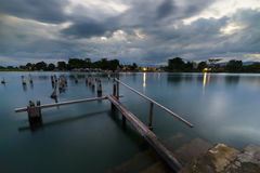 Old jetty on lake, long exposure at dusk, Sulawesi, Indonesia Stock Photos