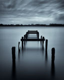 Old jetty in a misty loch Royalty Free Stock Photos