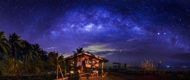 Old jetty night scene and lone house stock photography