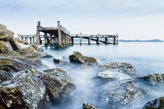 Old jetty and rocks royalty free stock photos