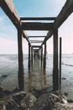 Old jetty by the sea. An old and forgotten jetty by the beach Royalty Free Stock Images