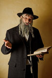 Old jew with book. Old jewish man with grey beard holding a book Royalty Free Stock Photography
