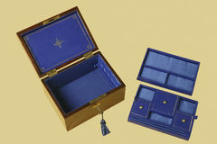 Old jewelry box with compartments on blue velvet Stock Image