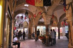The old jewelry  souk in medina Tunis. Decorated with flags after the revolution Royalty Free Stock Photos
