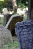 Old Jewish Cemetery. Details od some scattered tombstones in the Old Jewish Cemetery in Prague - Czech Republic Royalty Free Stock Photo