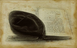 Old Jewish symbols. Traditional Jewish symbols - kippa and prayer book in Hebrew - in old time style Stock Image