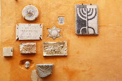 Old Jewish symbols in ghetto of Rome. Old Jewish symbols on outdoor wall of a narrow street of ghetto in Rome Stock Photos