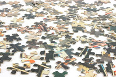 Old jigsaw puzzle pieces Royalty Free Stock Image