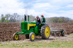 An old John Deere tractor in a plowing event Royalty Free Stock Photos