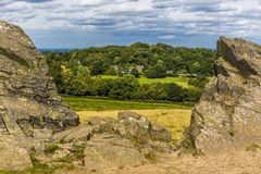 Old John folly in Bradgate Park, Leicestershire looking towards Warren Hill. A view from the top of the hill with Old John folly framed by 560 million year old Stock Photo