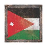 Old Jordan flag. 3d rendering of a Jordan flag over a rusty metallic plate wit a rusty frame. Isolated on white background Royalty Free Stock Images