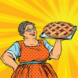 Old joyful retro woman with berry pie Royalty Free Stock Photography