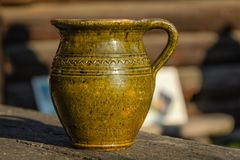 Old jug for honey Stock Photo