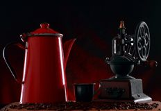 Old jug and retro coffee grinder Royalty Free Stock Image