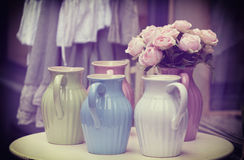 Old jugs on a table Stock Photography