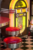 Old Jukebox. An old diner jukebox and stools