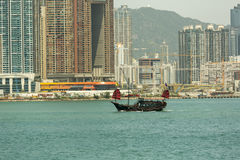 Old junk boat in Hong Kong. A junk is an ancient Chinese sailing ship design that is still in use today. Junks were used as seagoing vessels as early as the 2nd Stock Photography