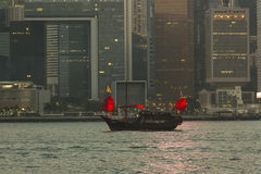Old junk boat in Hong Kong. A junk is an ancient Chinese sailing ship design that is still in use today. Junks were used as seagoing vessels as early as the 2nd Royalty Free Stock Photo