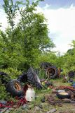 Old Junkyard Farm Tractor Body Parts. This is a old farm tractor graveyard with every kind of  junked parts Stock Images