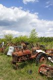 Old Junkyard Farm Tractor Body Parts. This is a old farm tractor graveyard with every kind of  junked parts Stock Photos