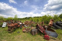 Old Junkyard Farm Tractor Body Parts. This is a old farm tractor graveyard with every kind of  junked parts Royalty Free Stock Photography