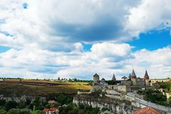 Kamianets-Podilskyi Castle in Ukraine. Old Kamianets-Podilskyi Castle under a cloudy blue sky. The fortress located among the picturesque nature in the historic royalty free stock photos