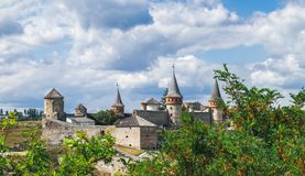 Kamianets-Podilskyi Castle in Ukraine. Old Kamianets-Podilskyi Castle under a cloudy blue sky. The fortress located among the picturesque nature in the historic royalty free stock image