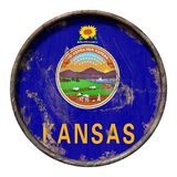 Old Kansas flag. 3d rendering of a Kansas State flag over a rusty metallic plate. Isolated on white background Stock Image