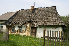Old Karpatian  home. House with wooden tiles. Carpathian traditional building of the late 19th century Stock Photography