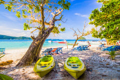 Old kayaks and beach chairs Stock Photo