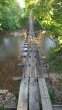An old Kentucky Swinging Bridge. A picture of an old swinging bridge on a hot summer day Stock Photos