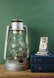 Old kerosene lamp and calendar Royalty Free Stock Photo