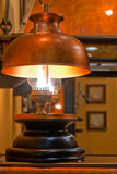 Old kerosene lamp with copper shade Stock Images