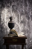Old kerosene lamp and open book Royalty Free Stock Images