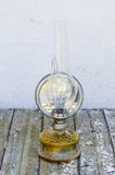 Old kerosene lamp. On the wooden table Stock Photo